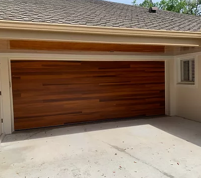 wooden garage door installed in a new home