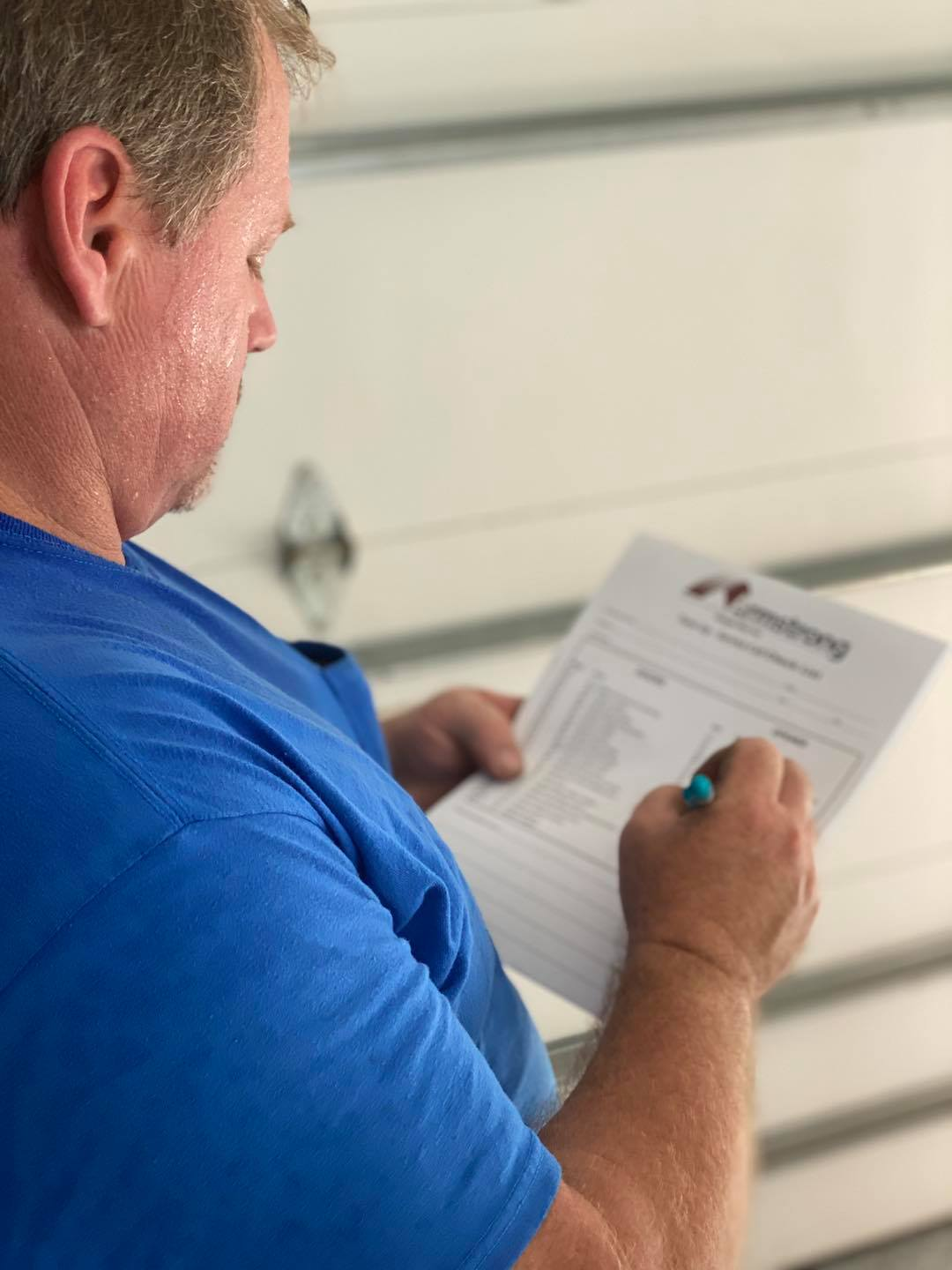 jeff boone using the 28 point checklist from armstrong garage door
