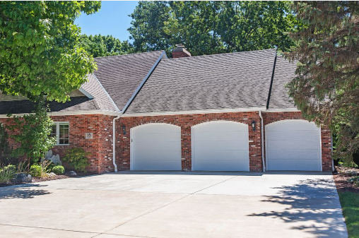 house with a short panel garage door
