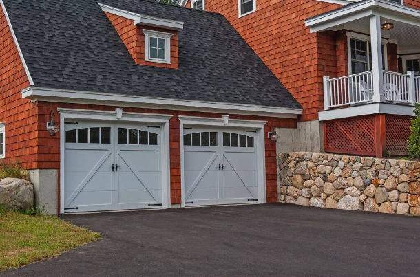2 steel carriage style garage doors