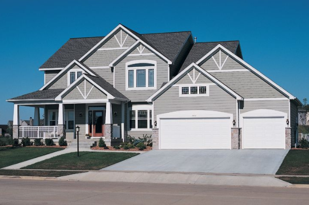 house with short and long panel garage doors