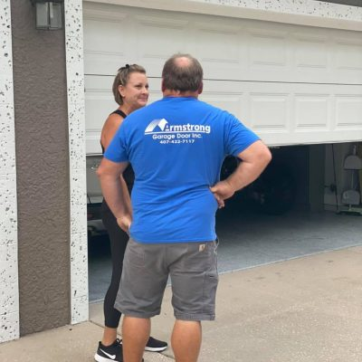 jeff boone meeting with an amrstrong garage door client